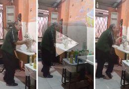 Dono de pet shop viraliza dançando com cão durante banho