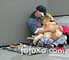 Fotos mostram amor de moradores de rua por seus cães - Foto 1